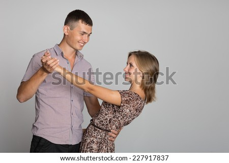 Happy young people standing in a dance pose - stock photo