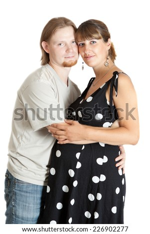 happy young pregnant woman and her boyfriend - stock photo