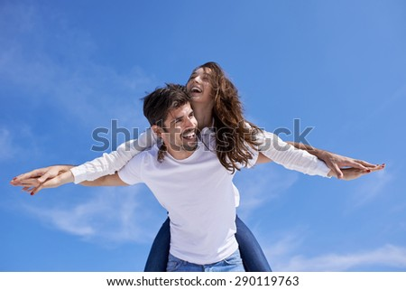 happy young romantic couple have fun relax smile at modern home outdoor terace balcony terace - stock photo