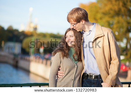 Happy young romantic couple outdoors - stock photo