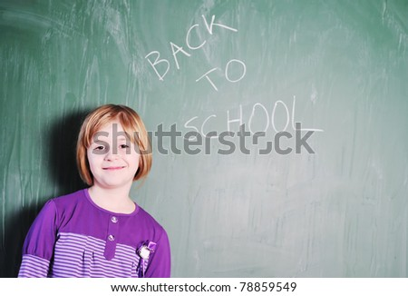 happy young school girl portrait on math class - stock photo