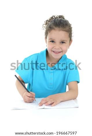 Happy Young Schoolgirl Doing Her Homework Isolated on White Background - stock photo