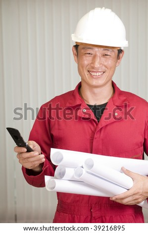 Happy young shipping marine engineer, working in office - stock photo