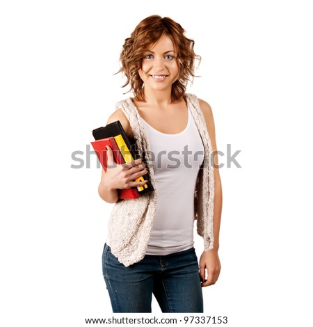 Happy young student girl holding books - stock photo
