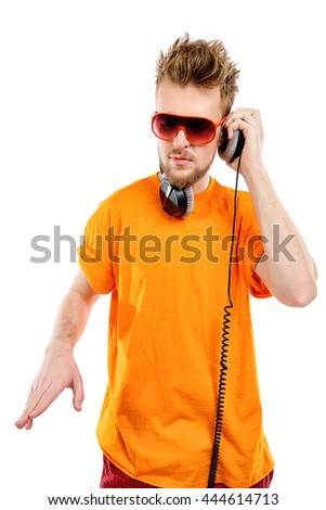 Happy young stylish man in headphones enjoying the music and expressing positive. Isolated over white. - stock photo