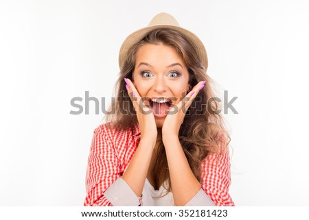 Happy young surprised woman with hat - stock photo