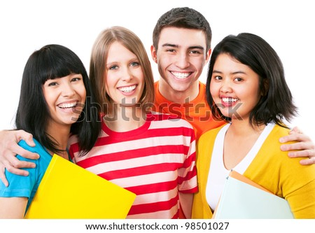 Happy young teenager students standing and smiling with books - stock photo