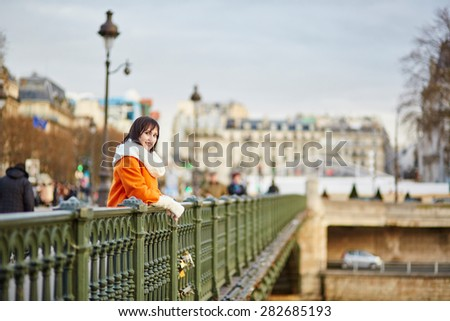 Happy young tourist walking in Paris on a fall, spring, or winter day - stock photo