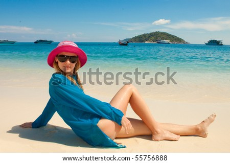 Happy young woman against azure sea - stock photo