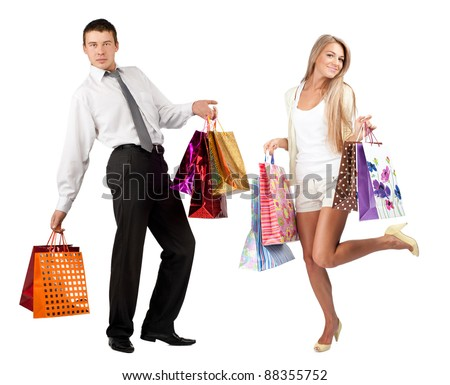 Happy young woman and handsome man with colorful shopping bags. Isolated on white background - stock photo