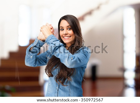 happy young woman celebrating sign - stock photo