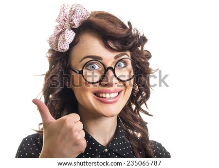 Happy young woman cheering and showing thumbs up. Smile pin up girl isolated on white - stock photo