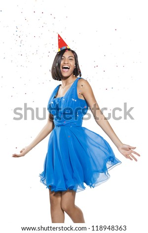 happy young woman dancing in a carnival party. white background. - stock photo