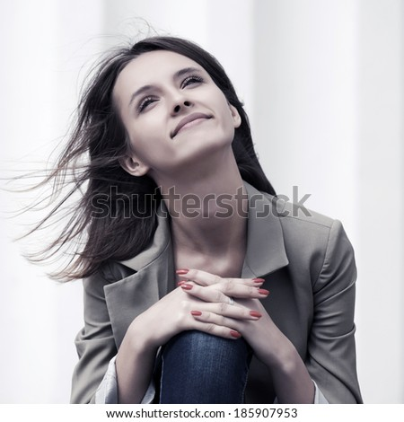 Happy young woman daydreaming outdoor - stock photo