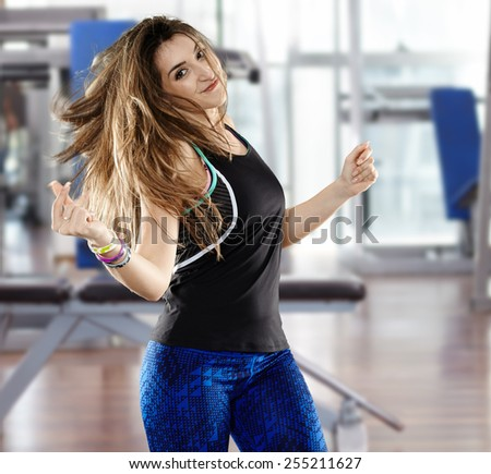 Happy young woman doing aerobics at the gym - stock photo