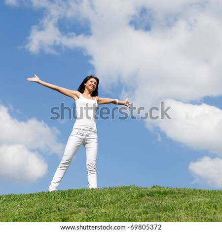 happy young woman dreams to fly on winds - stock photo