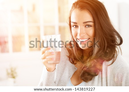happy young woman drinking coffee at home - stock photo