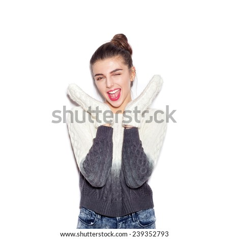 Happy young woman experiencing the joy raising her hands up. Beautiful Girl opening Mouth. Emotion.  Hairstyle. Make-up.  White background, not isolated - stock photo