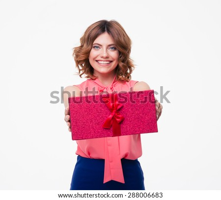 Happy young woman giving gift box on camera isolated on a white background - stock photo