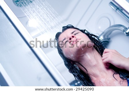 Happy young woman having a shower - stock photo