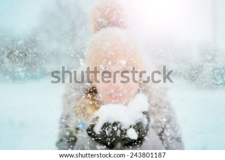 Happy young woman having fun in the snow - stock photo