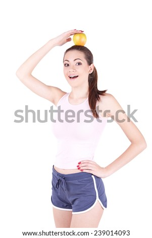 Happy young woman holding a apple and smiling - stock photo