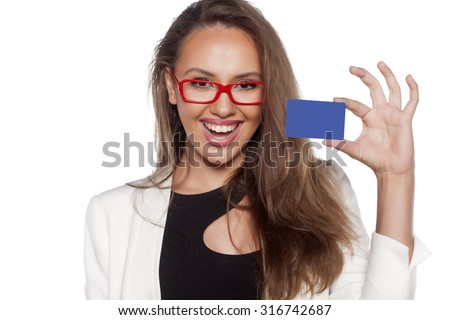 happy young woman holding a credit card on white background - stock photo