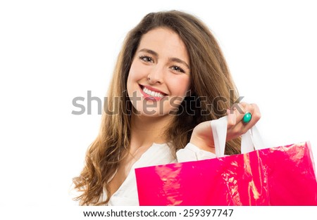 Happy young woman holding a shopping bag - stock photo