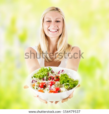 Happy young woman holding bowl with healthy fresh food . - stock photo