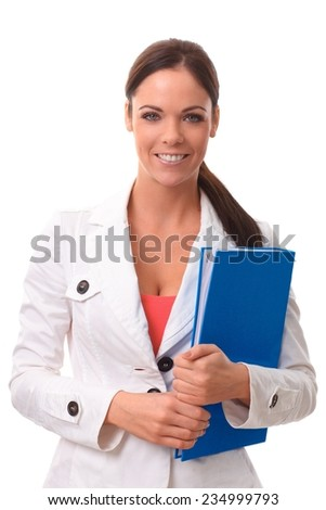 Happy young woman holding folder, smiling, looking at camera. - stock photo