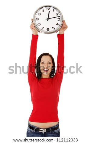 Happy young woman holding office clock, isolated on white background - stock photo