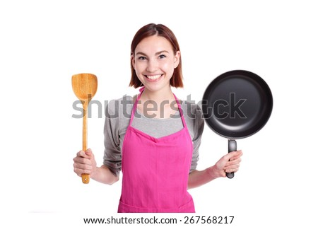 Happy young woman housewife Wearing Kitchen Apron while cooking isolated Over White Background, caucasian beauty - stock photo