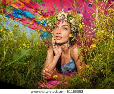 Happy young woman in flowers - stock photo