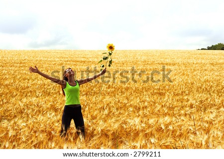 Happy young woman in the field - stock photo
