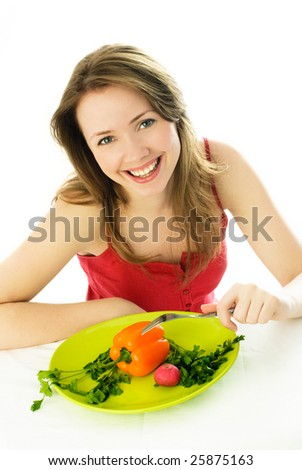 happy young woman keeping a diet and eating vegetables - stock photo