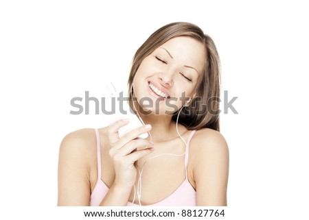 happy young woman listening to music - stock photo