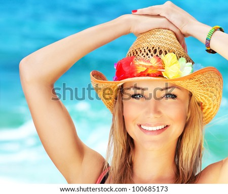 Happy young woman on the beach, beautiful female face outdoor portrait, pretty healthy girl relaxing outside, nature fun and joy, spa and travel concept - stock photo