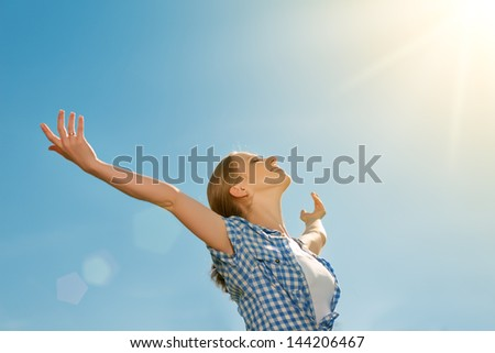 happy young woman open her arms to the sky and enjoying life - stock photo