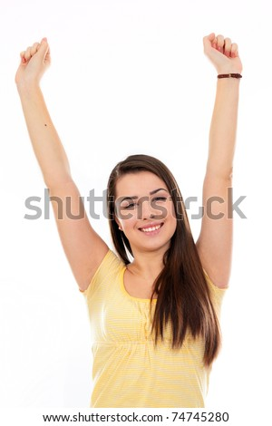 Happy young woman raising hands in joy and freedom against white background - stock photo