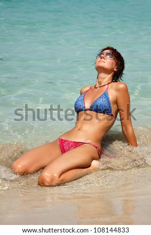 Happy young woman rest on the tropical beach - stock photo