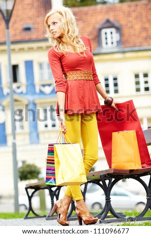Happy young woman shopping - stock photo