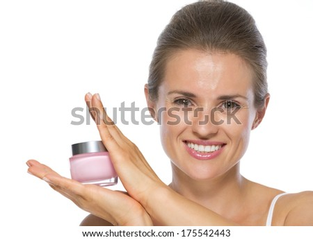 Happy young woman showing creme - stock photo
