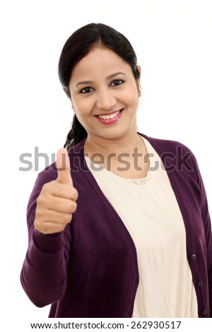 Happy young woman showing thumbs up gesture - stock photo