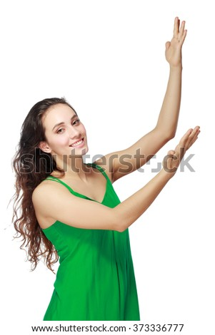 Happy young woman showing welcome gesture with hands isolated on a white background. Looking at camera - stock photo