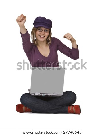 Happy young woman sitting with a laptop in her lap. - stock photo