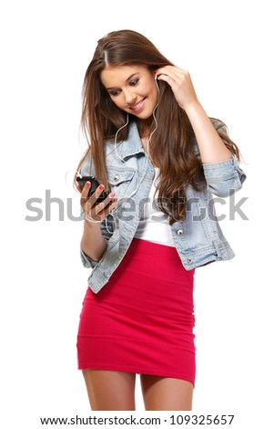 happy young woman speaking on earphone - stock photo