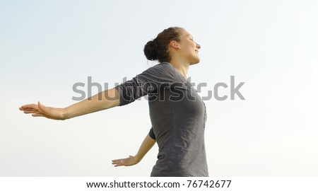happy young woman spreads her arms - stock photo