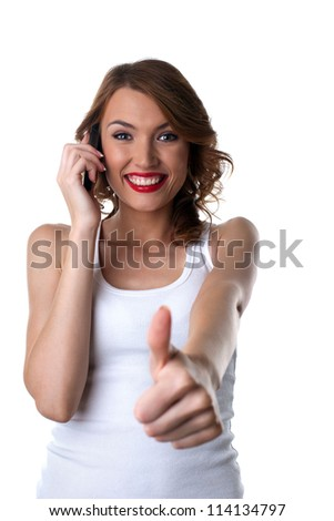 Happy Young woman talk on cell phone and thumbs up - stock photo