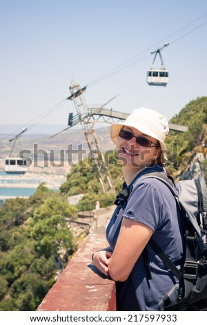 Happy young woman tourist on the Rock of Gibraltar. - stock photo