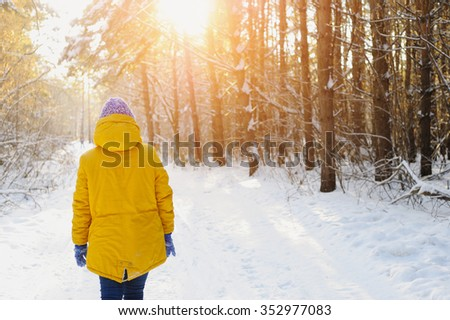 Happy young woman walking in the Park in winter - stock photo